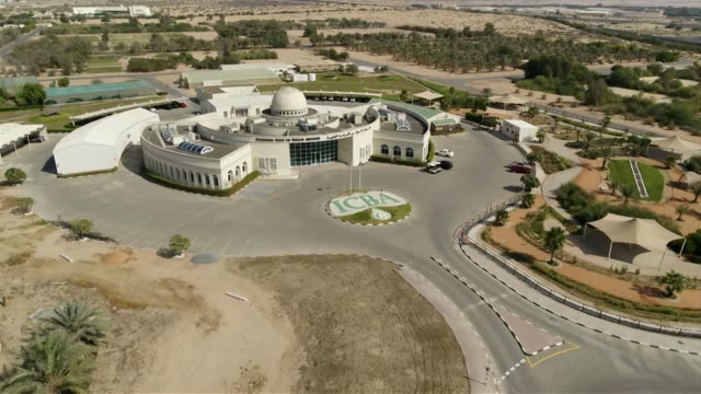 Drone aerials of the International Centre for Biosaline Agriculture in Dubai flying away from building