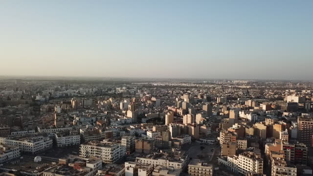 drone aerials over city rooftops and skyscrapers near coast and port of tripoli on 24th september 2017 in tripoli libya - libya stock videos & royalty-free footage