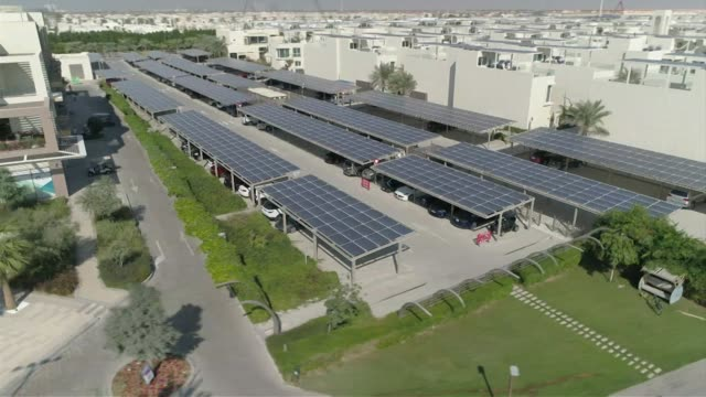 Drone aerials over the solar car park in the Sustainable City the first net zero energy development in Dubai