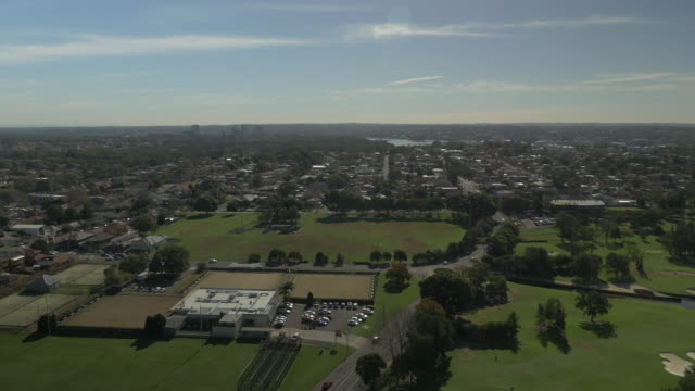 Drone aerials pan across Concord Briars Club tennis courts bowling greens and cricket nets Edwards Park playing fields Massey Park Golf Course...