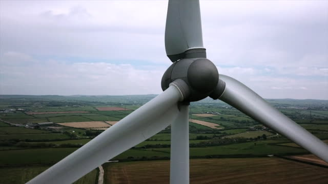 drone aerials wind turbines of first uk commercial wind farm in delabole cornwall - wind power stock videos & royalty-free footage
