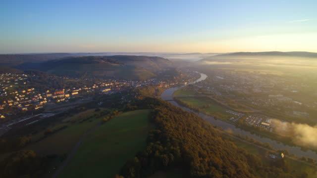 drone air view of saar valley near saarburg, district trier-saarburg, rhineland-palatinate, germany - saarburg stock-videos und b-roll-filmmaterial