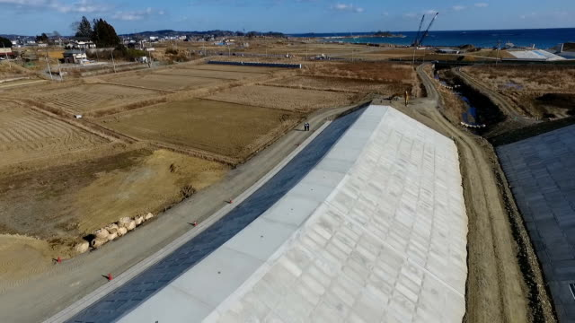 drone and handheld camera footage taken recently in kesennuma, miyagi prefecture, shows work progressing on the bed of the okinotagawa river between... - 800 meter stock videos & royalty-free footage