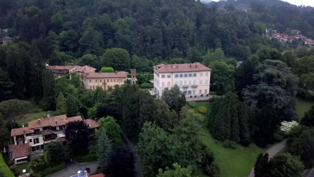 A drone approaches a luxury villa in Luvinate  Varese Lombardio Italy