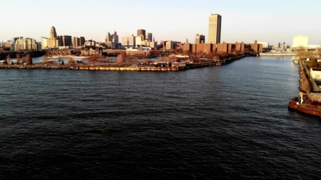 a drone approaches buffalo new york from lake erie - buffalo new york state stock videos & royalty-free footage