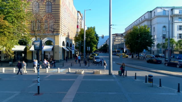 drone ascending from the sidewalk ground up to reveal main city street - bulgaria stock videos & royalty-free footage