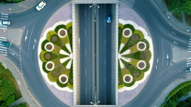 Drone ascending over traffic circle in slow motion 48FPS