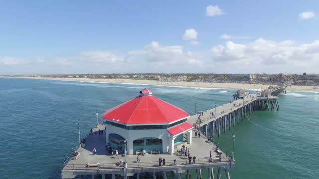 drone at the end of the pier in huntington beach - huntington beach california stock videos and b-roll footage