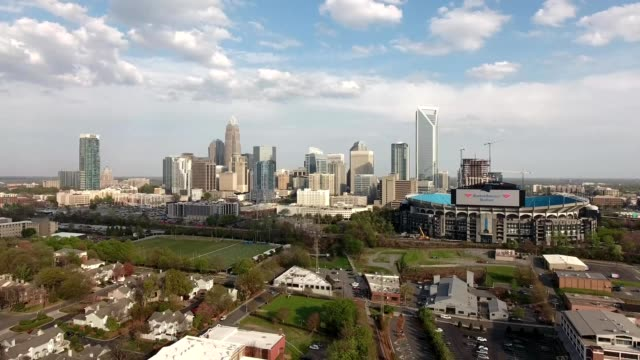 a drone backs away from downtown charlotte north carolina - charlotte north carolina stock videos & royalty-free footage