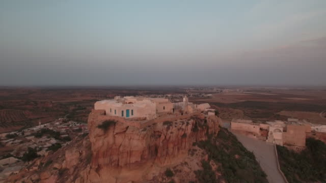 drone, beautiful sunset, desert, tunis, north africa, berber village - tunisia stock videos & royalty-free footage