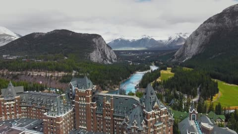 drone captured a hotel with mountains and a forest valley in banff, alberta, canada - canada stock videos & royalty-free footage