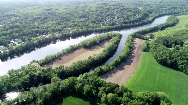 a drone captures a riverbed and countryscape in haverhill massachusetts - massachusetts stock videos & royalty-free footage