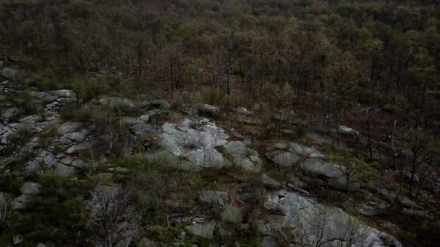 a drone captures a rock formation and rows of mountains in wilkes-barre township pennsylvania - wilkes barre stock videos & royalty-free footage