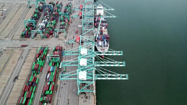 a drone captures a ship container at port tanjung pelepas in geland patah johor malaysia - johor stock videos & royalty-free footage