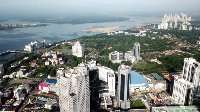 a drone captures a view of johor bahru city in malaysia - johor stock videos & royalty-free footage