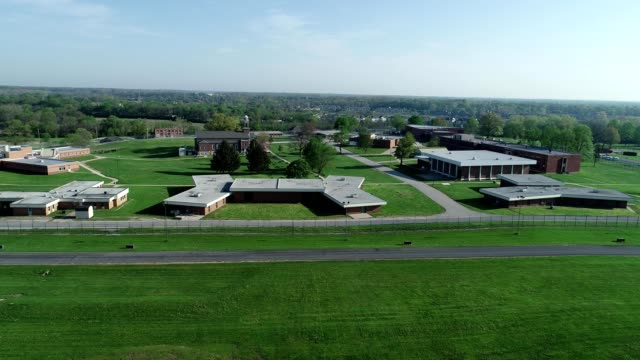 a drone captures a women's prison in indianapolis indiana - women prison stock videos & royalty-free footage