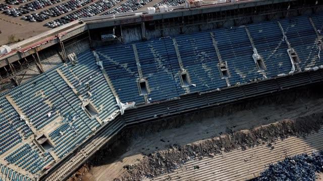 a drone captures an aerial view of pontiac silverdome demolition in michigan - ポンティアック点の映像素材/bロール