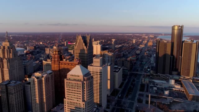drone captures buildings of downtown detroit michigan during sunset - detroit michigan stock videos & royalty-free footage