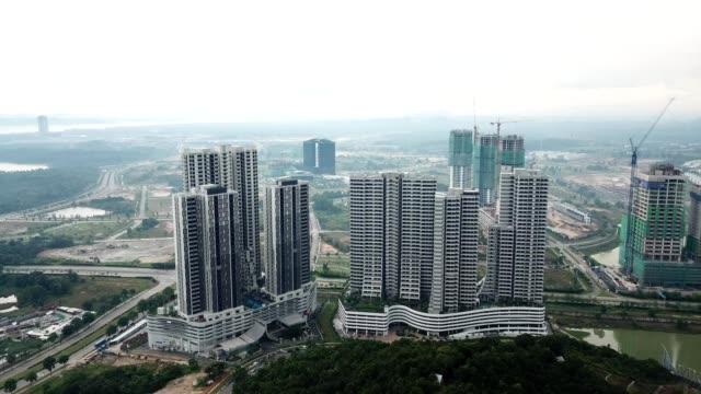 a drone captures high rise buildings in nusajaya johor malaysia - johor stock videos & royalty-free footage
