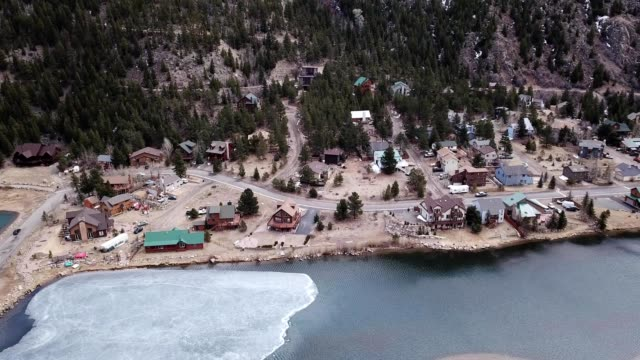 a drone captures homes along a thawing lakeside in georgetown colorado - colorado stock videos and b-roll footage