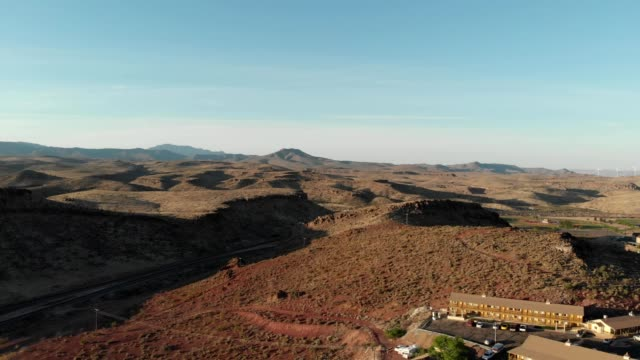 a drone captures mountains and train tracks in kingman arizona - kingman arizona stock videos & royalty-free footage