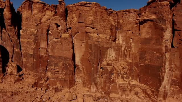a drone captures red rock canyon walls in moab utah - climbing stock videos & royalty-free footage