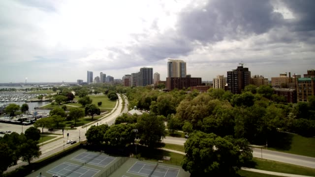 a drone captures the skyline of milwaukee wisconsin - wisconsin video stock e b–roll