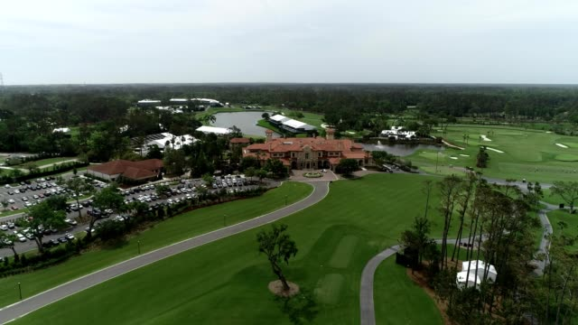 a drone captures tpc sawgrass country club golf course - country club stock videos and b-roll footage