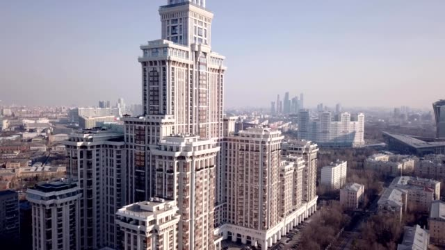 a drone captures triumph palace, the largest apartment building in europe, in moscow russia - モスクワ市点の映像素材/bロール