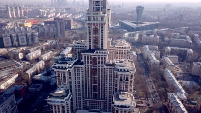 vídeos de stock, filmes e b-roll de a drone captures triumph palace, the largest apartment building in europe, in moscow russia - moscow russia