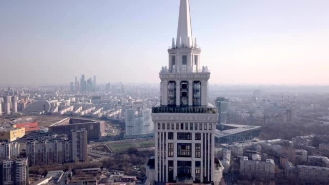 a drone captures triumph palace, the largest apartment building in europe, in moscow russia - grattacielo video stock e b–roll