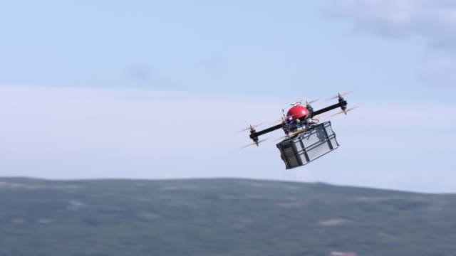 Drone carrying a package across the sky