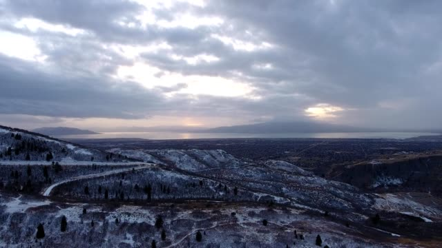 a drone catches a sunset above provo canyon before a snow storm in provo utah - provo stock-videos und b-roll-filmmaterial
