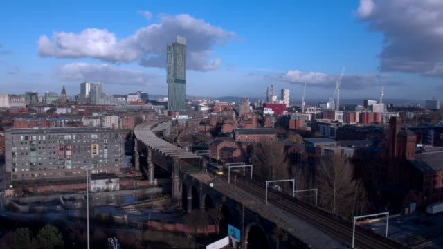 drone cityscape manchester,  with river irwell and trains, motorway - manchester england stock videos and b-roll footage
