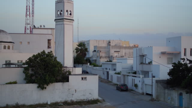 drone, cityscape, mosque, tunis at sunset - tunis stock videos & royalty-free footage