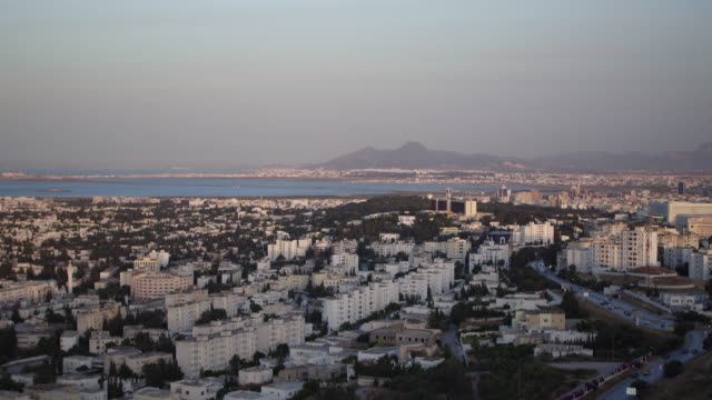 drone, cityscape, urban streets, tunis at sunset - tunis stock videos & royalty-free footage
