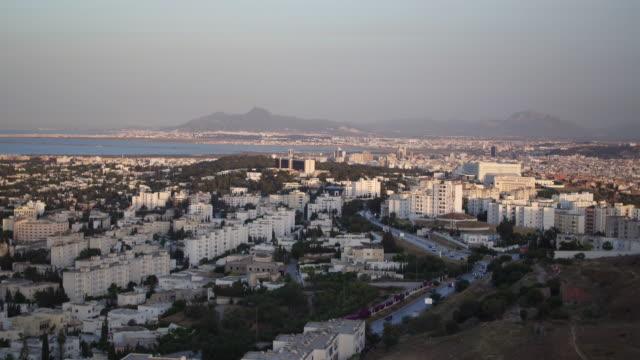 stockvideo's en b-roll-footage met drone, cityscape, urban streets, tunis at sunset - tunesië
