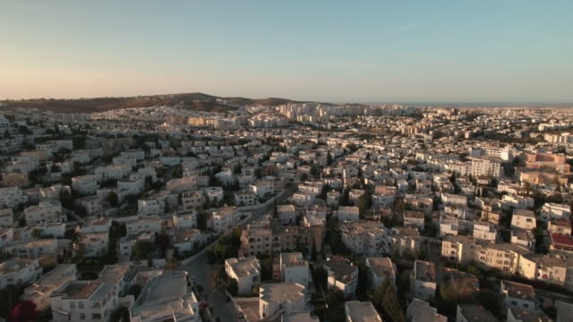 drone, cityscape, urban streets, tunis at sunset - tunisia stock videos & royalty-free footage