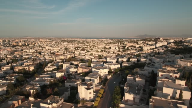 drone, cityscape, urban streets, tunis, rooftops, at sunset - tunisia video stock e b–roll