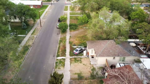 a drone clip of an old established neighborhood that has become dilapidated over time from poverty, low income and drug use - twilight stock videos & royalty-free footage