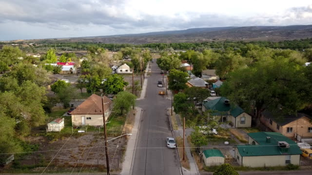 a drone clip of an old established neighborhood that has become dilapidated over time from poverty, low income and drug use - colorado stock videos & royalty-free footage