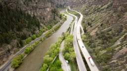 Drone Clip Of I-70 Highway In Colorado Through Glenwood Canyon With The Colorado River Flowing Beside The Highway
