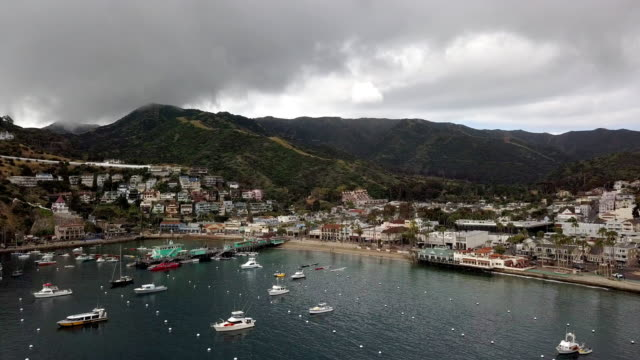 a drone clip of the beautiful town of avalon, catalina island pier, catalina casino and marina - channel islands california stock videos & royalty-free footage