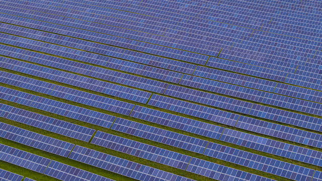 drone clip panning across a field of solar panels - power supply stock videos & royalty-free footage