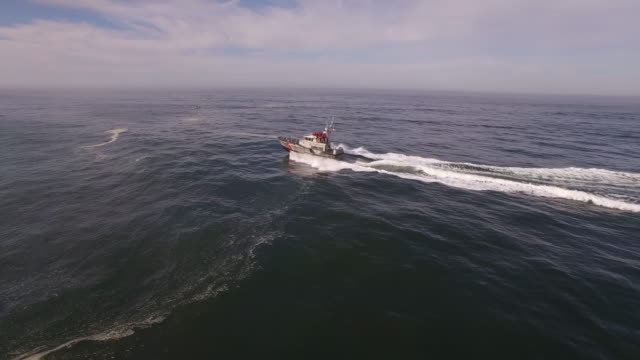 Drone Coast Guard Tracking far to close push Aerial, 4K, 44s, 5of7, Stock Video Sale