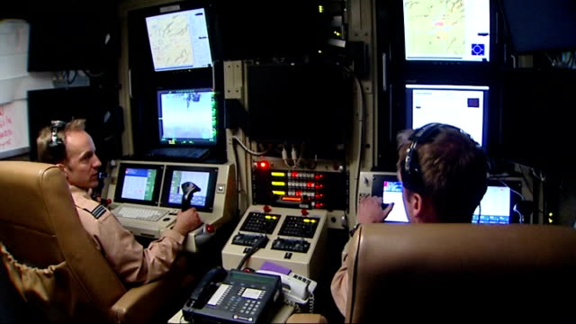 drone control room at camp bastion; more of drone operators and screens showing view from drone aircraft - control room stock videos & royalty-free footage