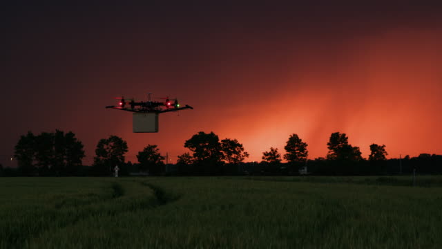 ws drone delivering a package at dusk - driverless car stock videos & royalty-free footage