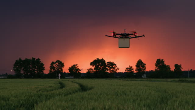 WS Drone delivering a package on a field at dusk
