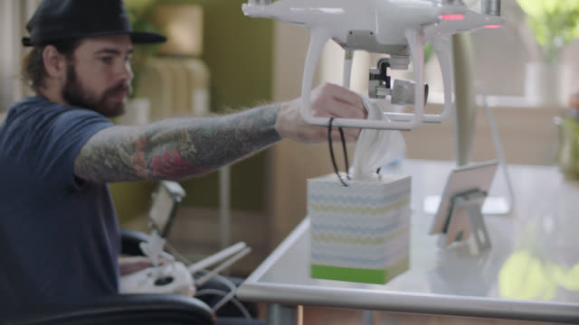 drone delivers a tissue box to man. - innovation stock videos & royalty-free footage