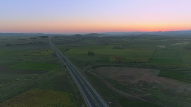 drone descending over trakia highway, bulgaria at dusk - country road stock videos & royalty-free footage